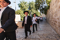 Israel,Jerusalem, young orthodox boys walk in the street of the old city