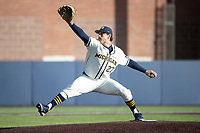 Michigan Wolverines pitcher Steven Hajjar (27) delivers a pitch to the plate during the NCAA baseball game against the Illinois Fighting Illini at Fisher Stadium on March 19, 2021 in Ann Arbor, Michigan. Illinois won the game 7-4. (Andrew Woolley/Four Seam Images)