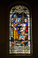 French Quarter, New Orleans, Louisiana.  St. Louis Basilica Stained Glass Window (1929) Depicting King Louis IX of France Overseeing Construction of the Sainte Chapelle in Paris.