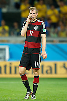 Per Mertesacker of Germany looks dejected