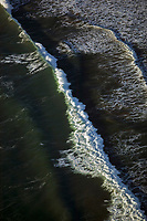 aerial photograph Pacific Ocean surf and waves at the California coast