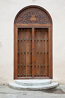 Zanzibar, Tanzania.  Entrance to Bokhara Mosque, Stone Town.  Indian-style door, with rounded top.
