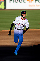 Wisconsin Timber Rattlers outfielder Garrett Mitchell (5) races to third base during a game against the Beloit Snappers on May 4, 2021 at Neuroscience Group Field at Fox Cities Stadium in Grand Chute, Wisconsin.  (Brad Krause/Four Seam Images)