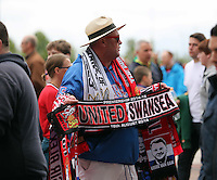 Pictured: Souvenir scarf sellers outside the Old Trafford. Saturday 16 August 2014<br /> Re: Premier League Manchester United v Swansea City FC at the Old Trafford, Manchester, UK.