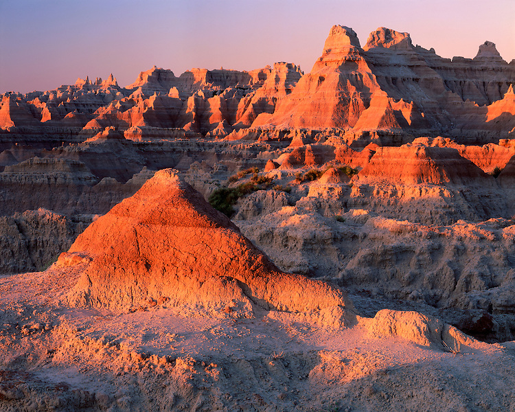 Sunrise light on the badland formations on the Door/Window Trail; Badlands National Park, SD