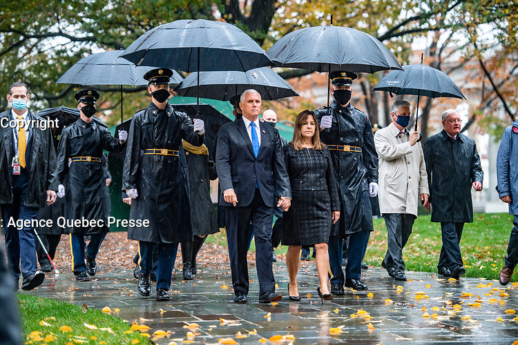 Vice President Mike Pence (center left), and Second Lady Karen Pence (center right) walk  near the Memorial Amphitheater at Arlington National Cemetery, Arlington, Virginia, November 11, 2020. President Donald J. Trump laid a wreath just prior to this photo at the Tomb of the Unknown Soldier in observance of Veterans Day. (U.S. Army photo by Elizabeth Fraser / Arlington National Cemetery / released)