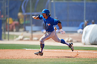 Toronto Blue Jays Nick Sinay (15) runs the bases during a minor league Spring Training game against the New York Yankees on March 30, 2017 at the Englebert Complex in Dunedin, Florida.  (Mike Janes/Four Seam Images)