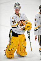 6 November 2009: University of Vermont Catamount goaltender Rob Madore, a Sophomore from Venetia, PA, stands at center ice after a game against the University of Massachusetts River Hawks at Gutterson Fieldhouse in Burlington, Vermont. The Hockey East rivals battled to a 3-3 tie. Mandatory Credit: Ed Wolfstein Photo