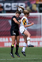 Lauren Berman (11) of Maryland goes up for a header with Megan Curan (4) of Wake Forest during the game at Ludwig Field in College Park, MD.  Maryland defeated Wake Forest, 1-0.