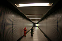 CHINA. Hong Kong. Young Muslim children passing through an underground tunnel. Officially the Hong Kong Special Administrative Region, it is a territory located on China's south coast on the Pearl River Delta. It has a population of 6.9 million people, and is one of the most densely populated areas in the world. 2008