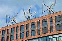 GERMANY Hamburg, small wind turbine on roof of Greenpeace builing in the Hafencity