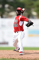 Batavia Muckdogs pitcher Juancito Martinez (29) delivers a pitch during the first game of a doubleheader against the Connecticut Tigers on July 20, 2014 at Dwyer Stadium in Batavia, New York.  Connecticut defeated Batavia 5-3.  (Mike Janes/Four Seam Images)