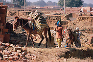 January 1979, New Delhi, India. In the outskirts of New Delhi, children are employed at a brick-making plant. - Child labor as seen around the world between 1979 and 1980 - Photographer Jean Pierre Laffont, touched by the suffering of child workers, chronicled their plight in 12 countries over the course of one year.  Laffont was awarded The World Press Award and Madeline Ross Award among many others for his work.