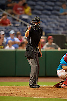 Umpire Justin Whiddon calls a strike during a Florida State League game between the Charlotte Stone Crabs and Clearwater Beach Dogs on July 26, 2019 at Spectrum Field in Clearwater, Florida.  Clearwater defeated Charlotte 6-5.  (Mike Janes/Four Seam Images)