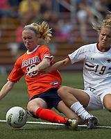 Boston College midfielder Kristen Mewis (19) fails to connect on a cross as University of Virginia midfielder/defender Maggie Kistner (16) defends. Boston College defeated University of Virginia, 2-0, at the Newton Soccer Field, on September 18, 2011.