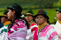"""Women, wearing colorful clothes, watch a procession during the Inti Raymi celebration in Pichincha province, Ecuador, 27 June 2010. Inti Raymi, """"Festival of the Sun"""" in Quechua language, is an ancient spiritual ceremony held in the Indian regions of the Andes, mainly in Ecuador and Peru. The lively celebration, set by the winter solstice, goes on for various days. The highland Indians, wearing beautiful costumes, dance, drink and sing with no rest. Colorful processions in honor of the God Inti (Sun) pass through the mountain villages giving thanks for the harvest and expressing their deep relation to the Mother Earth (Pachamama)."""