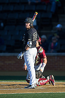 Will Craig (22) of the Wake Forest Demon Deacons looks to his third base coach for the signs during the game against the Florida State Seminoles at David F. Couch Ballpark on April 16, 2016 in Winston-Salem, North Carolina.  The Seminoles defeated the Demon Deacons 13-8.  (Brian Westerholt/Four Seam Images)