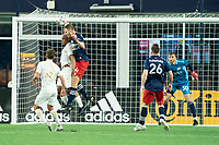 FOXBOROUGH, MA - MAY 1: Henry Kessler #4 of New England Revolution and Josef Martinez #7 of Atlanta United FC battle for a head ball during a game between Atlanta United FC and New England Revolution at Gillette Stadium on May 1, 2021 in Foxborough, Massachusetts.