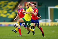 20th March 2021; Carrow Road, Norwich, Norfolk, England, English Football League Championship Football, Norwich versus Blackburn Rovers; Teemu Pukki of Norwich City under pressure from Joseph Rankin-Costello of Blackburn Rovers