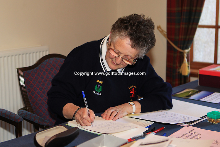 Dorothy Scott works out the final results from The Paul Lawrie Foundation Scottish Schools Golf Championships played at Murrayshall House Hotel and Golf Courses on 10th June 2013: Picture Stuart Adams www.golftourimages.com: 10th June 2013