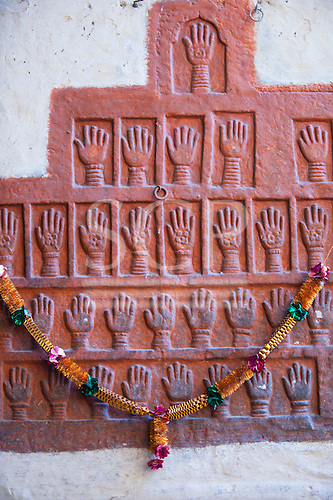 Jodhpur, India. Mehrangarh fort of the Marwar rulers. Red hand prints of the wives of Maharajahs subjected to suttee at the Loha Pol iron gate.