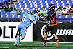 Face-Off Classic:  Midfielder Greg McBride #3 of the North Carolina Tar Heels moves in for a check on Attackmen Alex Capretta # 33 of the Princeton Tigers during the Princeton v North Carolina mens lacrosse game at M&T Bank Stadium on March 10, 2012 in Baltimore, Maryland.(Ryan Lasek/Eclipse Sportswire)