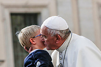 Pope Francis poses kisses a child at the end of his weekly general audience in St. Peter's Square at the Vatican City, October 16, 2019.<br /> UPDATE IMAGES PRESS/Riccardo De Luca<br /> <br /> STRICTLY ONLY FOR EDITORIAL USE