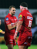 (L-R) Paul Asquith of the Scarlets celebrates with team mate Werner Kruger their win during the Guinness PRO14 Round 6 match between Ospreys and Scarlets at The Liberty Stadium , Swansea, Wales, UK. Saturday 07 October 2017