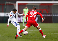 10th January 2021; Broadfield Stadium, Crawley, Sussex, England; English FA Cup Football, Crawley Town versus Leeds United; Pablo Hernández of Leeds united moving the ball wide of Jake Hessenthaler of Crawley
