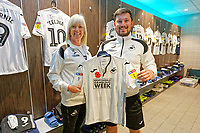 Sue and Michael Eames with the Swansea kit inside the changing room prior to the Sky Bet Championship match between Rotherham United and Swansea City at the AESSEAL New York Stadium, Rotherham, England, UK. Saturday 03 November 2018
