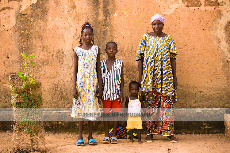 In Ouagadougou, Burkina Faso, a Mossi family stands against a wall in the neighborhood of Hamdallaye for a portrait.