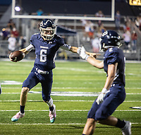 Greenwood's quarterback LD Richmond directs traffic as he runs with the ball in the first half of Friday's game against Springdale Har-Ber.