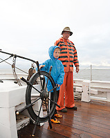 Young boy, and Captain, navigating the Historic Tall Ship, A.J. Meerwald, Delaware Bay, New Jersey