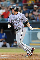 Kannapolis Intimidators first baseman Patrick Palmeiro #24 swings at a pitch during a game against the Asheville Tourists at McCormick Field on May 10, 2013 in Asheville, North Carolina. The Intimidators won the game 5-2. (Tony Farlow/Four Seam Images).