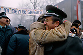 Ostpreu Bendamm, Germany<br /> November 14, 1989 <br /> <br /> An East German woman embraces a guard after crossing the border near the Berlin Wall. Germans gathered as the wall is dismantled and the East German government lifts travel and emigration restrictions to the West on November 9, 1989.