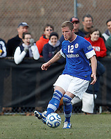 Creighton University midfielder Zach Barnes (12) passes the ball. .NCAA Tournament. Creighton University (blue) defeated University of Connecticut (white), 1-0, at Morrone Stadium at University of Connecticut on December 2, 2012.