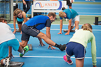 Almere, Netherlands, 24 september 2016, Kickoff Jong Oranje, warming up with fitness trainer Miguel Janssen<br /> Photo: Tennisimages.com/Henk Koster