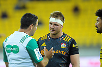 Referee Ben O'Keefe talks to Chiefs co-captain Sam Cane during the Super Rugby Aotearoa match between the Hurricanes and Chiefs at Sky Stadium in Wellington, New Zealand on Saturday, 20 March 2020. Photo: Dave Lintott / lintottphoto.co.nz
