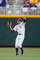 LSU Tiger outfielder Andrew Stevenson (6) throws the ball into the infield during Game 4 of the 2013 Men's College World Series against the UCLA Bruins on June 16, 2013 at TD Ameritrade Park in Omaha, Nebraska. UCLA defeated LSU 2-1. (Andrew Woolley/Four Seam Images)