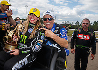Mar 20, 2016; Gainesville, FL, USA; NHRA top fuel driver Brittany Force (left) is embraced by her father John Force as they celebrate after defeating Terry McMillen to win the Gatornationals at Auto Plus Raceway at Gainesville. Mandatory Credit: Mark J. Rebilas-USA TODAY Sports