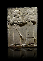 "Hittite monumental relief sculpted orthostat stone panel of Royal Buttress. Basalt, Karkamıs, (Kargamıs), Carchemish (Karkemish), 900-700 B.C. Anatolian Civilisations Museum, Ankara, Turkey.<br /> <br /> King Araras holds his son Kamanis from the wrist. King carries a sceptre in his hand and a sword at his waist while the prince leans on a stick and carries a sword on his shoulder. <br /> <br /> Hieroglyphs reads; ""This is Kamanis and his siblings. I held his hand and despite the fact that he is a child, I located him on the temple. This is Yariris' image"".  <br /> <br /> Against a black background."