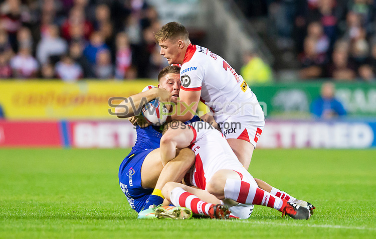 Picture by Allan McKenzie/SWpix.com - 04/10/2018 - Rugby League - Betfred Super League - The Super 8's - St Helens v Warrington Wolves - The Totally Wicked Stadium, Langtree Park, St Helens, England - Warrington's Tom Lineham is brought down by St Helens' Matty Lees & Luke Thompson.