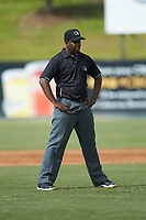 Umpire Dexter Kelley handles the calls on the bases during the South Atlantic League game between the Hagerstown Suns and the Kannapolis Intimidators at Kannapolis Intimidators Stadium on May 6, 2018 in Kannapolis, North Carolina. The Intimidators defeated the Suns 4-3. (Brian Westerholt/Four Seam Images)