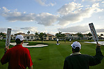 """PALM BEACH GARDENS, FL. - Marshalls on hole 17, also known as """"The Bear Trap"""" hold up their """"Quiet Please"""" paddles while Sergio Garcia putts during Round One play at the 2009 Honda Classic - PGA National Resort and Spa in Palm Beach Gardens, FL. on March 5, 2009."""