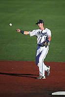 Ryan Grotjohn (16) of the Hillsboro Hops throws to first base during a game against the Spokane Indians at Ron Tonkin Field on July 22, 2017 in Hillsboro, Oregon. Spokane defeated Hillsboro, 11-4. (Larry Goren/Four Seam Images)