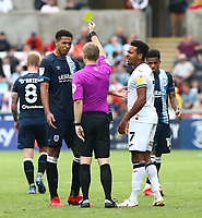 25th September 2021; Swansea.com Stadium, Swansea, Wales; EFL Championship football, Swansea versus Huddersfield; Levi Colwill of Huddersfield Town and Korey Smith of Swansea City are both given a yellow card during the second half