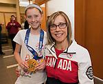 VERNON, B.C.--April 02, 2014---Canadian Paralympic gold medallist in wheelchair curling, Sonja Gaudet, meets young fan Madison Barrett, age 10,  at the CIBC Vernon main branch for the CIBC Paralympian Welcome Home event. (Canadian Press Images/Jeff Bassett)<br /> VERNON, C.-B. - le 2 avril 2014---La médaillée d'or paralympique canadienne en curling en fauteuil roulant, Sonja Gaudet, rencontre un jeune partisan de 10 ans, Madison Barrett, au centre bancaire principal de la CIBC à Vernon pour la fête de retour paralympique de la CIBC. (Photo: Canadian Press Images/Jeff Bassett)