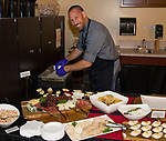"""Chef Christian Christensen prepares appetizers before the Reno Magazine """"Bubbles Tasting"""" event at Total Wine in Reno on Friday night, February 9, 2018."""