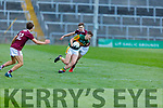 Kerry's Sean O'Brien under pressure from the tackle by Alan Greene of Galway in the U20 All Ireland football semi final.