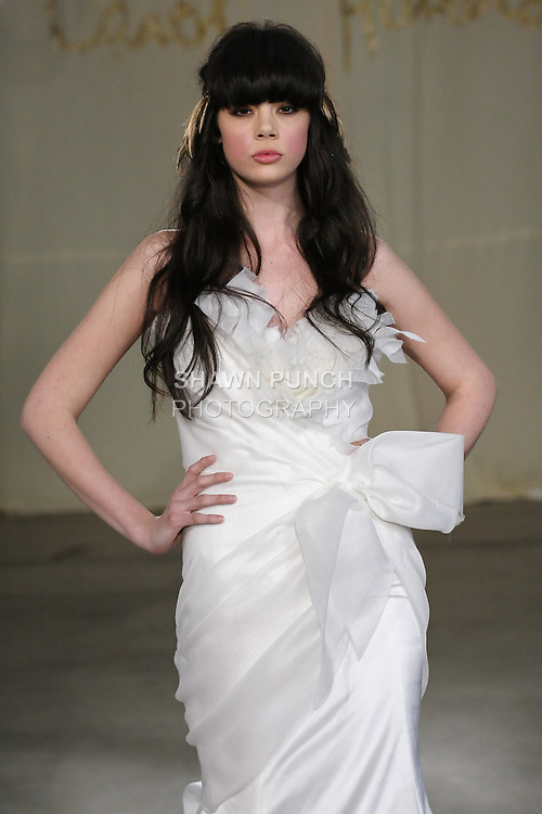 Model walks runway in a White Cedar wedding dress by Carol Hannah Whitfield, for the Carol Hannah Spring Summer 2012 Bridal collection runway show.